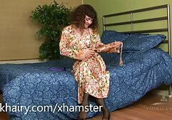 A girl wearing lingerie stroking her xxx hd film pussy.